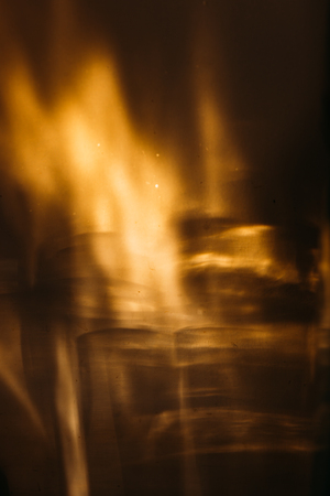 Glass goblets cast beautiful shadow and beautiful caustic effect as light passes through a glass in early morning