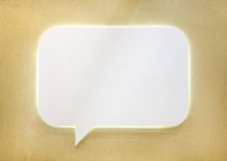 Empty white speech bubble on wooden wall