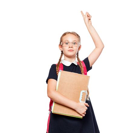 8 years old schoolgirl with a backpack wearing uniform standing isolated over a white background. Ready for school