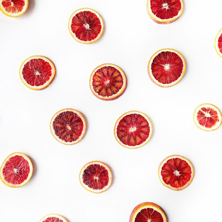 Red oranges pattern isolated on white. Flat lay Zdjęcie Seryjne