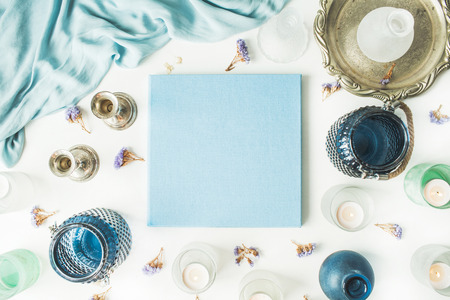 blue flowers: blue wedding or family photo album, vintage old-fashioned golden tray, candlesticks, flowers, silk dress isolated on white background. flat lay, overhead view