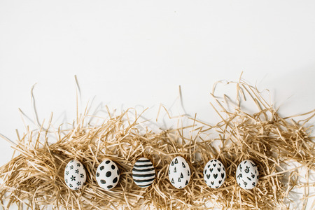 stars and stripes: Easter eggs painted in monochrome style isolated on white. Flat lay. Drops, flowers, hearts, stars, stripes Stock Photo
