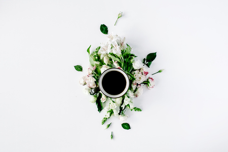 minimal: Colorful bright image made of leaves, roses and petals with coffee cup on white. flat lay, top view