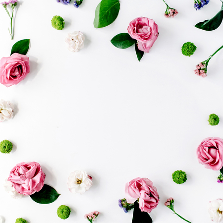 round frame wreath pattern with roses, pink flower buds, branches and leaves isolated on white background. flat lay, top view Foto de archivo