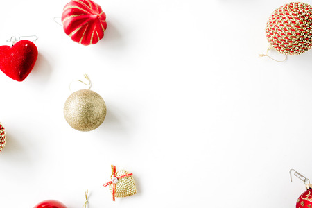 tinsel: christmas decoration with christmas glass balls, tinsel, bow. christmas wallpaper. flat lay, top view