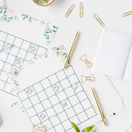 wedding planner schedule calendar painted with watercolor, laptop, notebook and accessories. flat lay workspace, top view Stock Photo