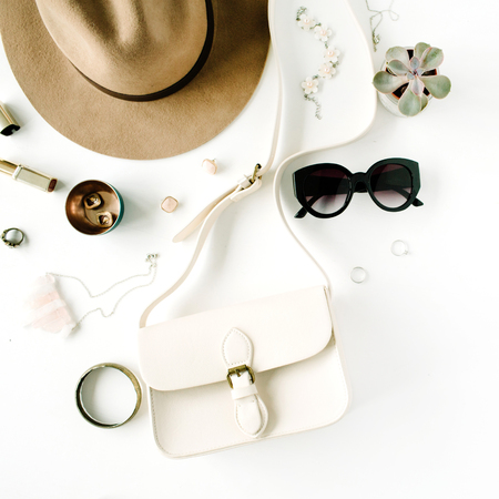 Flat lay trendy creative feminine accessories arrangement. Purse, hat, sunglasses, female accessories. Top view Фото со стока - 67687875