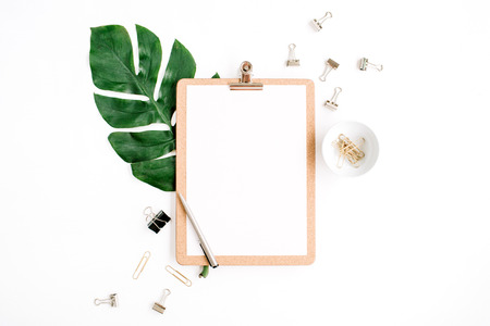 Home office workspace mockup with clipboard, palm leaf and clips. Flat lay, top view