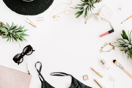 Summer casual style. Frame of modern woman clothes and accessories collage. Dress, sunglasses, hat, purse, lipstick and pineapples. Flat lay, top view