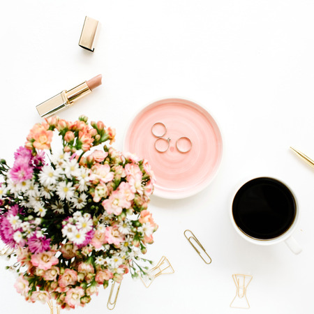 Wildflowers bouquet, coffee cup, golden pen, clips and accessories. Styled flat lay mockup