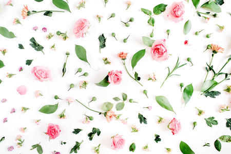 Floral pattern made of pink and beige roses, green leaves, branches on white background. Flat lay, top view. Valentines background 版權商用圖片
