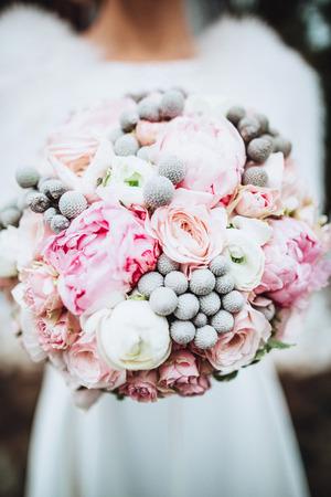 Beauty wedding bouquet in brides hands Stock Photo