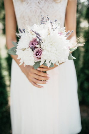 Beauty wedding bouquet in brides hands Stock Photo