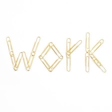 Word Work made of golden clips. Minimalistic flat lay, top view composition.