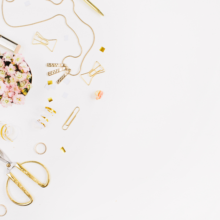 Beauty blog background. Gold style feminine accessories. Golden tinsel, scissors, pen, rings, necklace, bracelet on white background. Flat lay, top view. Stock Photo