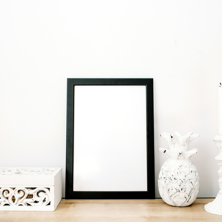 stuff: Front view blank mock up of photo frame with pineapple and trendy stuff at white background. Minimalistic decorated home office concept.