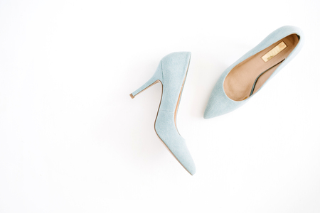 Beauty blog concept. Pale blue female shoes on white background. Flat lay, top view trendy fashion feminine background. Imagens