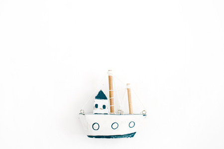Wooden handmade toy boat on white background. Flat lay, top view