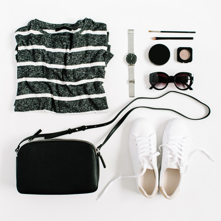 Trendy fashion black styled woman clothes and accessories collection on white background. Flat lay, top view.
