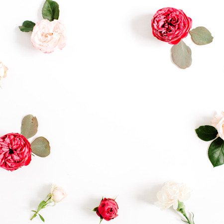 Round frame wreath pattern with red and beige rose flower buds, branches and leaves isolated on white background. Flat lay, top view. Floral background