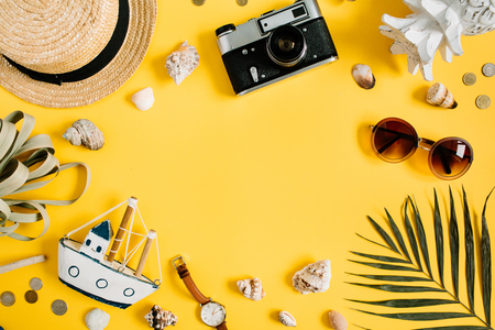 Flat lay traveler accessories on yellow background with blank space for text. Top view travel or vacation concept. Summer background. Stok Fotoğraf