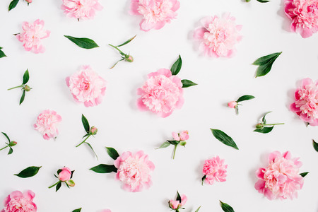 Flower pattern of pink peony flowers, branches, leaves and petals on white background. Flat lay, top view. Peony flower texture. Zdjęcie Seryjne - 83605756