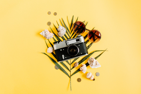 Flat lay traveler accessories on yellow background. Top view travel or vacation concept. Summer background. Stok Fotoğraf