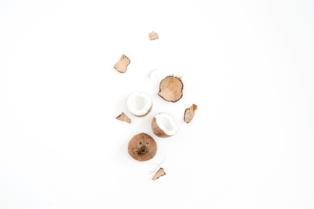 Cracked coconut on white background. Flat lat, top view Stock Photo