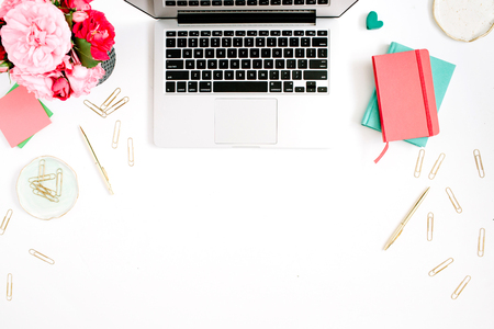 Flat lay home office desk. Female workspace with laptop, pink and red roses bouquet, golden accessories, red and mint diary on white background. Top view feminine background. 写真素材