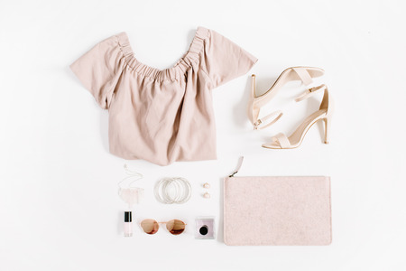 Woman fashion clothes and accessories collage on white background. Flat lay, top view feminine background. Zdjęcie Seryjne - 84086792