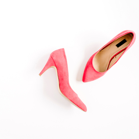 Beauty blog concept. Red female shoes on white background. Flat lay, top view trendy fashion feminine background. Imagens