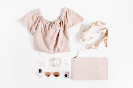 Woman fashion clothes and accessories collage on white background. Flat lay, top view feminine background.