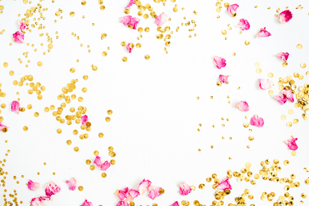 Mock up frame made of pink rose petals and golden confetti on white background. Flat lay, top view. Foto de archivo