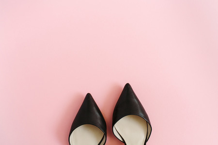 Fashion blog look. Black women high heel shoes on pink background. Flat lay, top view trendy beauty female background. Stock fotó