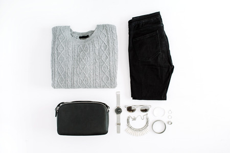 Women's fashion clothes and accessories on white background. Flat lay female styled look. Top view.