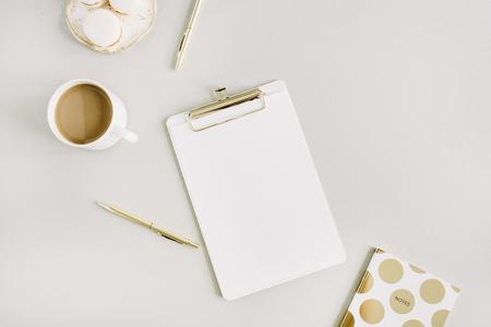 Minimal Home Office Desk With Clipboard, Macaroons, Pen, Coffee Mug. Flat  Lay
