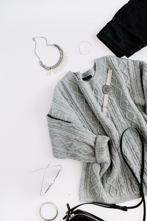 Women fashion cloth and accessories. Flat lay female casual style look with warm sweater, jeans, purse, watch, sunglasses. Top view. Banco de Imagens - 86803555