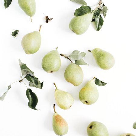 Minimalistic pears fruit and leaves pattern on white background. Flat lay, top view.