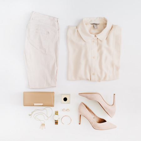 Women modern fashion clothes and accessories. Flat lay female casual style look with pastel pink jeans, blouse, high heels, perfume, gold watch. Top view. Banco de Imagens