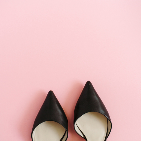 Fashion blog look. Black women high heel shoes on pink background. Flat lay, top view trendy beauty female background. Imagens