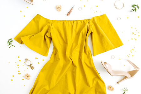 Womens fashion clothes and accessories on white background. Flat lay female golden styled look. Top view.
