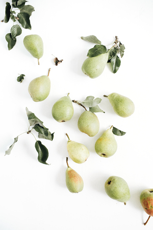 Minimal pears fruit and leaves pattern on white background. Flat lay, top view.