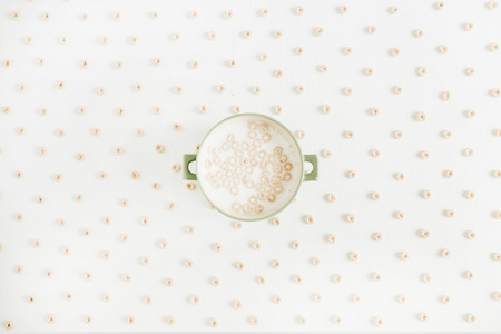 Cereals with milk on white background. Flat lay, top view.