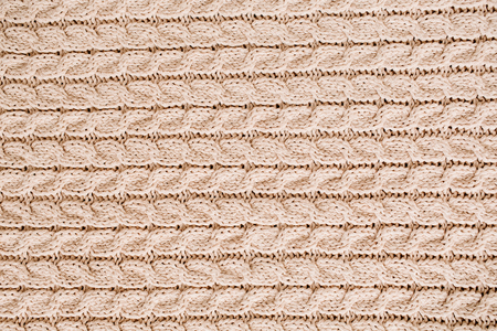 Beige knitted wool texture pattern. Stock Photo
