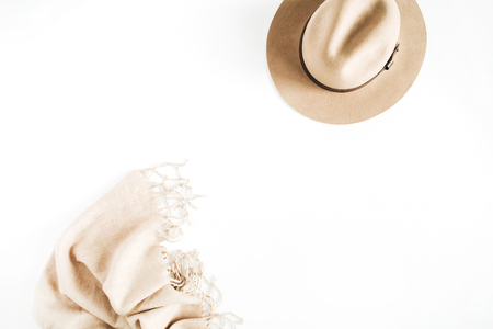 Fashion look with pale pastel beige hat and scarf on white background. Flat lay, top view. Stock fotó