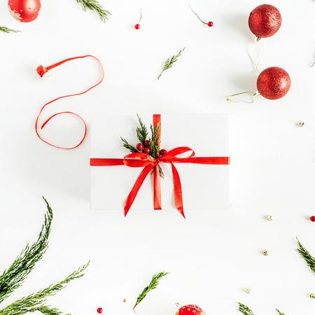 Beautiful Christmas gift box on white background. Flat lay, top view. Фото со стока