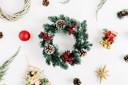 Christmas composition. Holiday wreath frame on white background. Flat lay, top view holiday decoration concept. Imagens