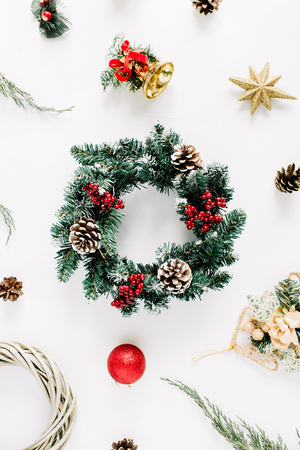 Christmas composition. Holiday wreath frame on white background. Flat lay, top view holiday decoration concept. Фото со стока