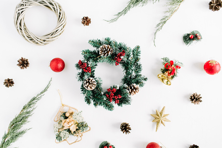 Christmas composition. Holiday wreath frame made of fir branches with cones, juniper, bells, glass Christmas balls on white background. Flat lay, top view holiday decoration concept. Imagens - 89062314