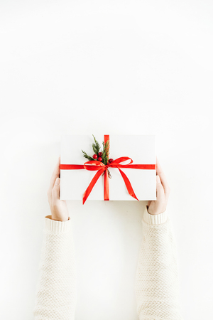 Christmas concept. Gift box in women hands. Flat lay, top view.